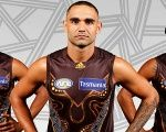 Indigenous AFL players Bradley Hill, Shaun Burgoyne and Cyril Rioli wear the Hawthorn FC Indigenous jersey