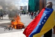 Protesters clash with police in Caracas.