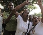 Members of the Ladies in White dissident group shout anti-communism slogans during a protest on International Human Rights Day, in Havana December 10, 2013.