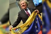 Luis Almagro poses with a Venezuelan flag during a meeting with Venezuelan opposition members in Miami, Florida, April 13, 2017.