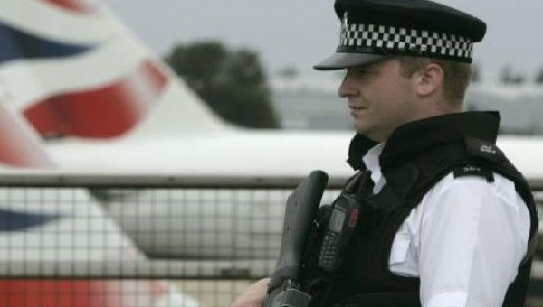 An armed policeman patrols Heathrow Airport, London.