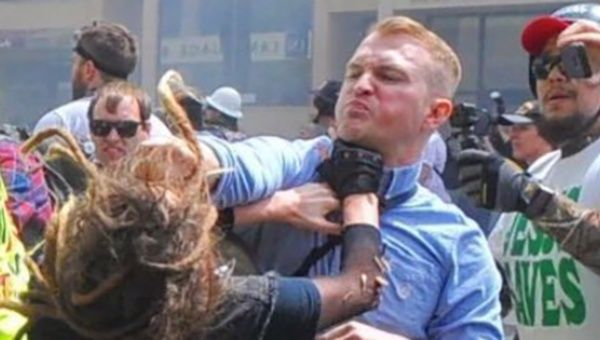 Louise Rosealma being punched by Identity Evropa leader Nathan Damigo.