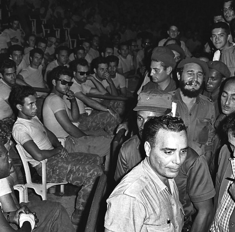 Cuban President Fidel Castro enters a public trial for captured members (seated) of the failed Bay of Pigs invasion in Havana.
