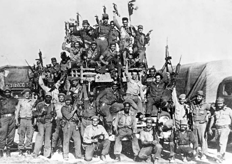 The militias and fighters of Bay of Pigs celebrate their hard-fought victory.