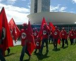 Members of Brazil's Landless Workers' Movement march outside the National Congress.