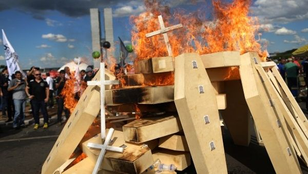 Striking police officers set fire to coffins in Brasilia during a protest by police officers from several Brazilian states against pension reforms.