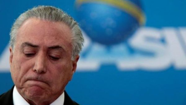Michel Temer does his best godfather pose.