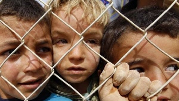 Children in a refugee camp in Jordan .