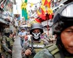Armed security forces take a part in a drug raid, in Manila, Philippines, Oct. 7, 2016.