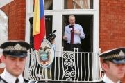 WikiLeaks founder Julian Assange stands outside of the Ecuadorean embassy in London.