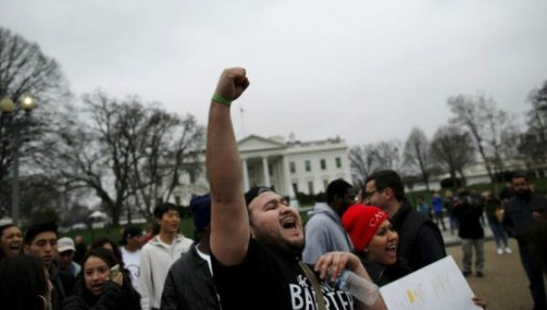 Anti-deportation demonstrators protest outside of the White House