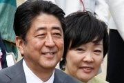 Japan's Prime Minister Shinzo Abe (L) and his wife Akie attend a cherry blossom viewing party at Shinjuku Gyoen park in Tokyo, Japan, April 15, 2017.
