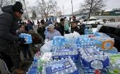 Volunteers distribute bottled water to help combat the effects of contaminated water in Flint, Michigan.