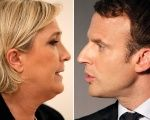 Marine Le Pen (L), French National Front political party leader, and Emmanuel Macron, head of the political movement En Marche!