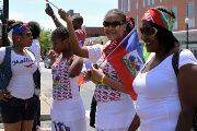 Members of the community take part in the Haitian-American Unity Parade in Boston, Massachussets, May 20, 2012.