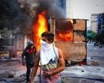 Venezuelan opposition protesters set up a road block during an anti-government protest.