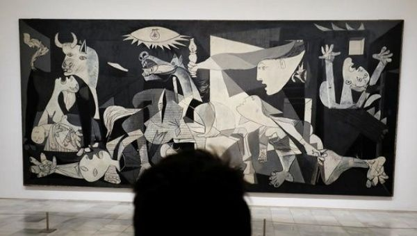 A man looks at Spanish artist Pablo Picasso