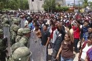 Mexican protesters confront the marines sent in to disband them.
