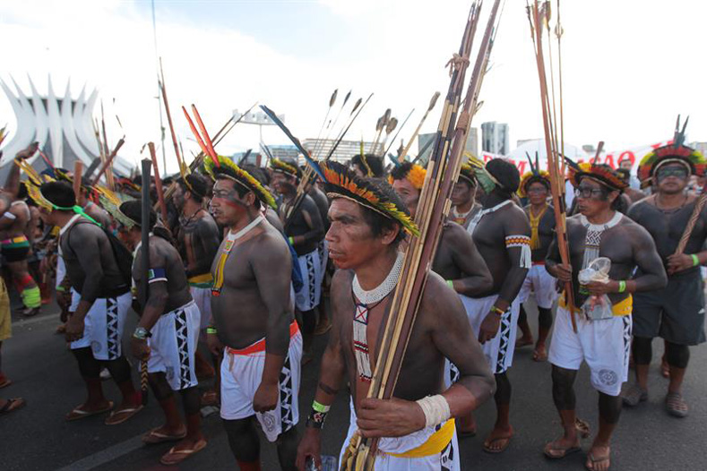 Brazilian Indigenous people take part in a demonstration against the violation of Indigenous people