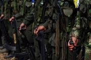 FARC members stand during a formation in a camp before moving to the transitional zone of Pueblo Nuevo, at the Los Robles FARC camp, Colombia, Jan. 25, 2017.