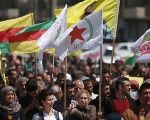 Kurds carry flags as they protest, in the northeastern city of Qamishli, against Turkish airstrikes on the headquarters of the Kurdish fighters from the People's Protection Units (YPG) in Mount Karachok on Tuesday, Syria April 26, 2017.