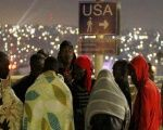 Haitians refugees wait to cross the U.S.-Mexican border