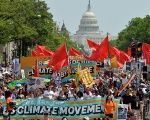 Demonstrators march down Pennsylvania Avenue during a People's Climate March in Washington, D.C., on April 29, 2017.