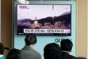 People watch a TV broadcast of a news report on North Korea's missile launch, at a railway station in Seoul, South Korea, on April 29, 2017.