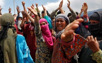 Kashmiri women react during a protest near the site of an attack on an Indian army base by suspected separatist militants in Panzgam in Kashmir