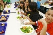 Students at Rose Hill Elementary School enjoy their lunch in Commerce City, Colorado May 1, 2012