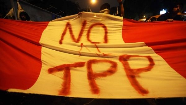 Demonstrators against the Transpacific Economic Cooperation Agreement in Lima, Peru, on January 8, 2016.