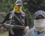 Members of a right-wing paramilitary group deliver a message in a self-released video.