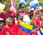 Supporters of the Venezuela's Bolivarian Revolution in El Salvador show their support and bash the OAS.