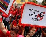 Workers of state-run oil company PDVSA take part in a 2015 rally against U.S. imperialism. The placard reads: