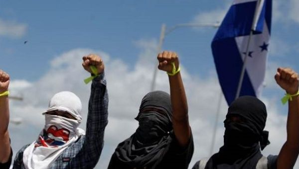 Honduran campesinos participate in anti-government protests.