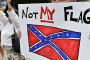 Protesters rallied in Columbia on Tuesday to demand the flag's removal from South Carolina's state capitol.