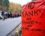 An anti-oil tanker sign is pictured near a demonstration against the proposed Kinder Morgan pipeline on Burnaby Mountain.