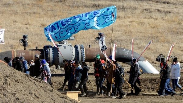 Protesters march along the pipeline route during a protest against the Dakota Access pipeline in St. Anthony, North Dakota, on November 11, 2016.