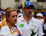 Lilian Tintori, wife of jailed Venezuelan opposition leader Leopoldo Lopez, and Henrique Capriles, opposition leader and Governor of Miranda State, attend a women's march to protest against President Nicolas Maduro's government in Caracas, Venezuela May 6, 2017.
