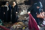 Palestinian women look at the damage at the Dawabsha family's home in the West Bank village of Duma on Aug. 4, 2015, after it was burned by Jewish extremists.