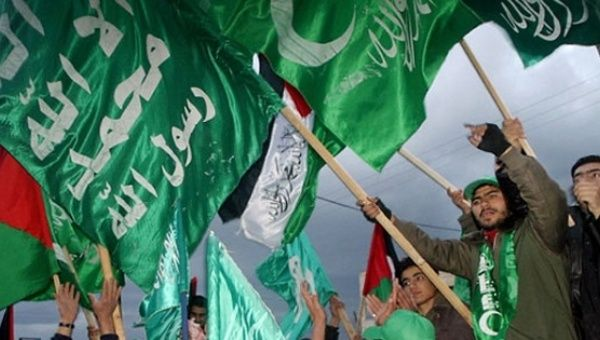 Hamas supporters wave flags during a rally in Gaza.