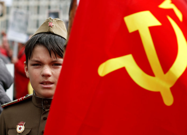A boy is pictured beside a Soviet flag during celebrations to mark Victory Day in Berlin, Germany May 9, 2017.