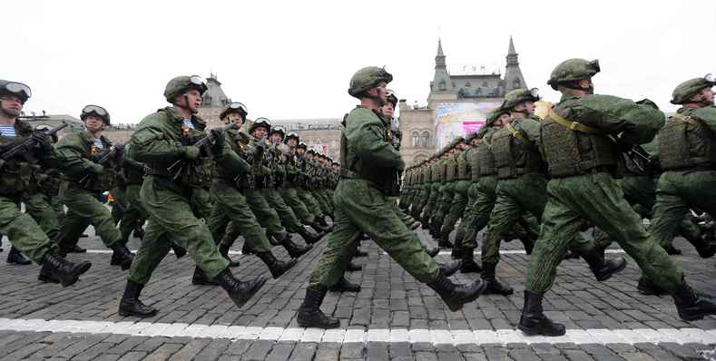 - Russian servicemen march during the Victory Day military parade .