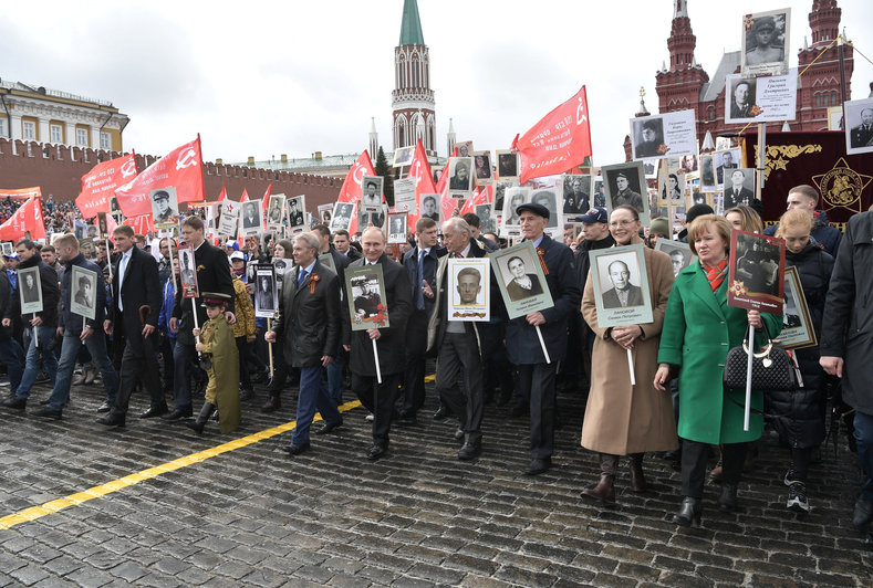 Russian President Vladimir Putin carries the portrait of his father, war veteran Vladimir Spiridonovich Putin, as he attends the Immortal Regiment march during the Victory Day celebrations, marking the 72nd anniversary of the victory over Nazi Germany in World War Two, at Red Square in Moscow, Russia May 9, 2017.