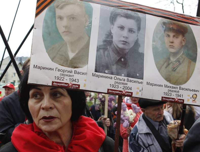 A woman holds pictures of World War Two soldiers as she take part in the Immortal Regiment march during the Victory Day celebrations, marking the 72nd anniversary of the victory over Nazi Germany in World War Two, in the southern city of Stavropol, Russia, May 9, 2017.