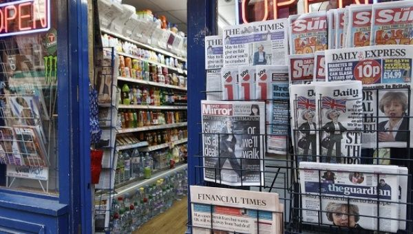 Newspapers on sale with front pages with news of British Prime Minister Theresa May