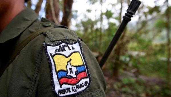 A member of the Revolutionary Armed Forces of Colombia is seen at a camp in Cordillera Oriental, Colombia, August 16, 2016.