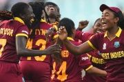 West Indies's Stafanie Taylor (left) with Hayley Matthews (right) and teammates celebrate their victory in the World T20 cricket tournament women's final match.