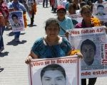 Relatives of the 43 missing students of the Ayotzinapa teacher training college march before receiving the final report on the disappearance of their sons by members of the Inter-American Commission on Human Rights (IACHR) in Tixtla, Guerrero state, Mexico, April 27, 2016.