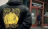 A man in a Bad Boys Bail Bonds jacket waits outside the Sheriff